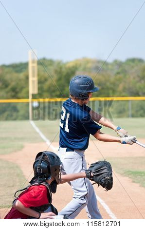 Teen Baseball Boy swinging the bat