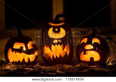 Photo Of Three Pumpkins For Halloween.