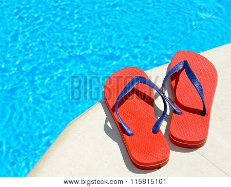 Pair Of Red Flip-flops On The Swimming Pool