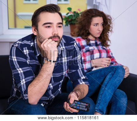 Woman Being Bored Watching Tv With Boyfriend
