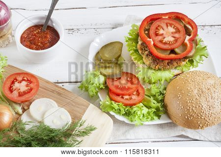 Homemade hamburger on white plate