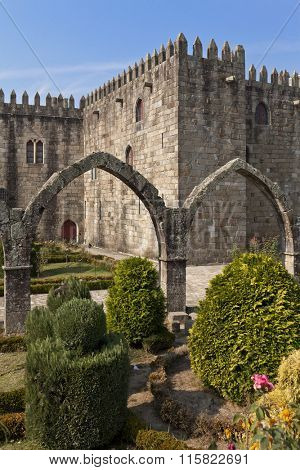 Braga, Portugal - July 27, 2015: Santa Barbara garden with the medieval Episcopal Palace of Braga in background.