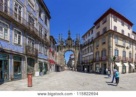 Braga, Portugal - July 27, 2015: Arco da Porta Nova Gate. A Baroque Monumental Arch built in the 18th century to be the main city gate and a landmark of the city.