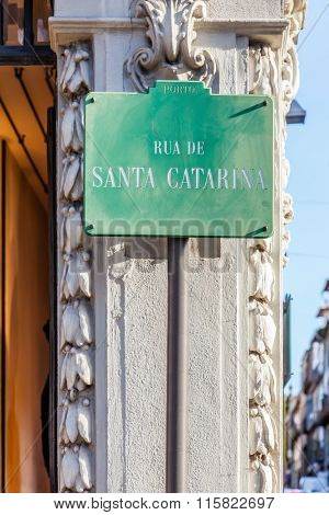 A street sign showing Rua de Santa Catarina, the name of the most commercial street of the city of Porto, where large brands locate their stores. Porto, Portugal.