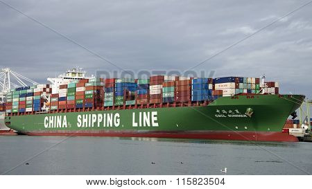 China Shipping Lines cargo ship SUMMER loading docked at the Port of Oakland