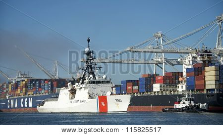 Coast Guard Cutter (CGC) BERTHOLTH, is escorted by Tug Boats past the Port of Oakland
