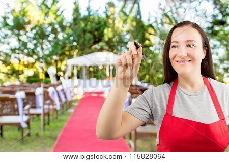 Waitress Writing On The Whiteboard At The Wedding