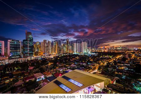 View Of The Skyline Of Makati At Night, In Metro Manila, The Philippines.