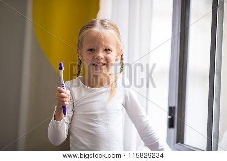 Dental hygiene. Adorable little smile girl brushing her teeth