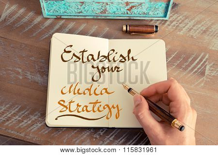 Handwritten Text Establish Your Media Strategy
