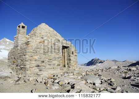 Stone Hut high in the Sierra Nevada Mountains of California. This hut is along the Pacific Crest Trail at the top of a mountain pass at 12,100 ft. Some hikers choose to stay the night in the 1920s built structure.