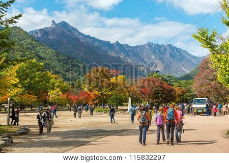 Seorak, Sokcho, South Korea - October 23, 2013: Tourists at the entrance of Seoraksan National Park, South korea
