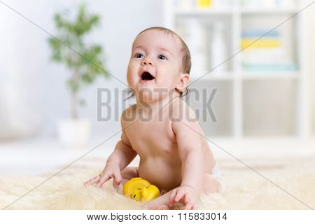 baby sitting on floor at home