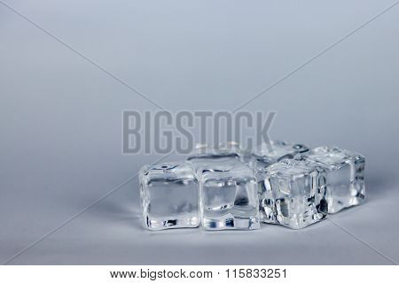 Ice Cubes On Grey Background On White Background