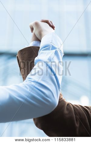 Two Businessmen Grasping Hands Together