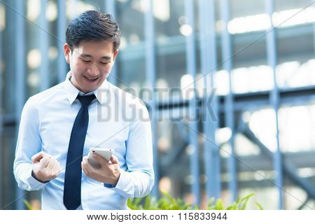 Happy Asian Businessman Receiving A Good News