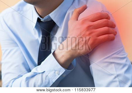 Man Having Shoulder Pain Problem With Red Spot
