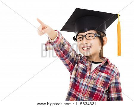 Happy School Kid In Graduation Cap With Pointing Gesture