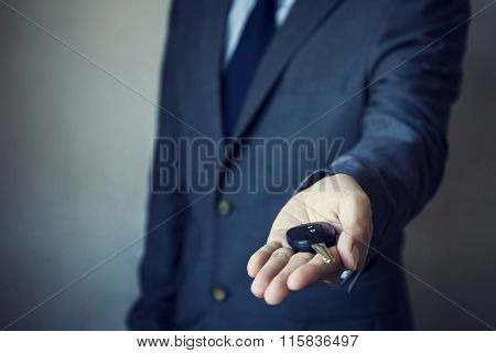 Businessman In Suit Giving A Car Key