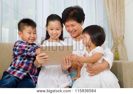 Senior Woman And Grandchildren