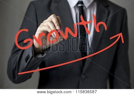 Businessman Writing And Drawing 'growth'.