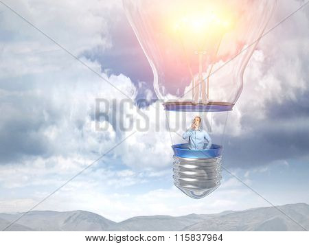 thinking man on 3d bulb balloon