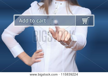 Businesswoman pressing add to cart button on virtual screens.