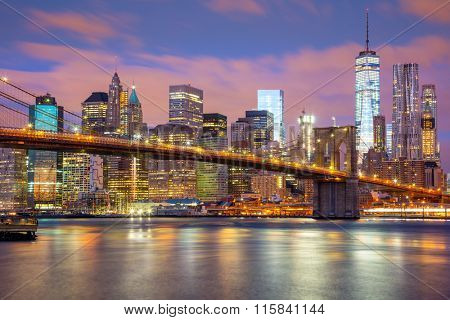 Manhattan skyscrapers and Brooklyn Bridge - beautiful gentle colors of sky and city illuminations, New York, USA