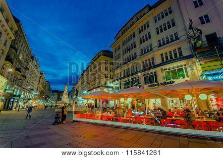 Vienna, Austria - 11 August, 2015: Walking around Singerstrasse and Graben area as evening lights se
