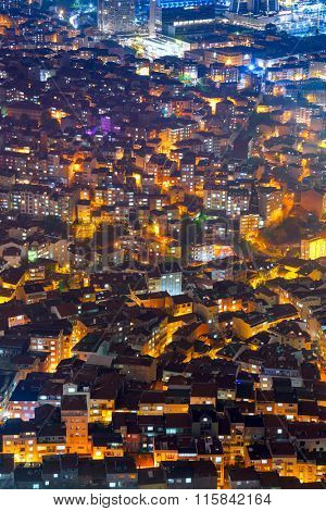 Aerial view of the city with houses and illuminated streets at night time, Istanbul, Turkey
