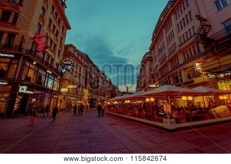 Vienna, Austria - 11 August, 2015: Walking around Singerstrasse and Graben area as evening lights se