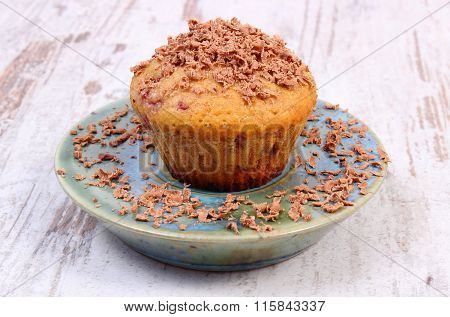 Baked Muffins With Raspberries And Grated Chocolate On Wooden Background, Delicious Dessert