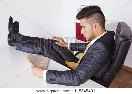 Businessman taking a break at his office