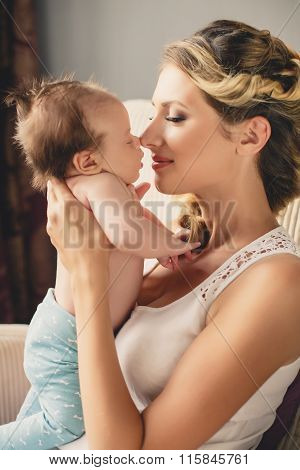 Portrait of a young mother and newborn son at home