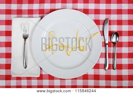Plate in place setting with the word