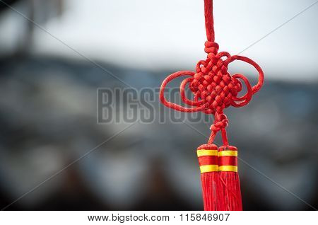 A Red Chinese Knot Decoration Hanging In A Suzhou Street