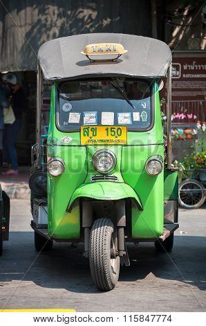 Green Tuk-tuk Parked On A Bangkok Street