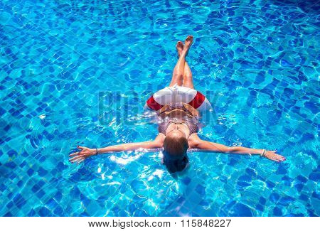 Top view of a girl in the pool