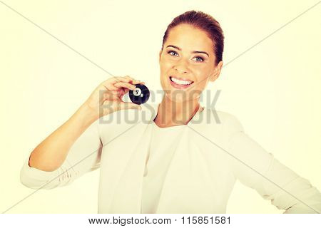 Happy businesswoman holding eight billiard ball