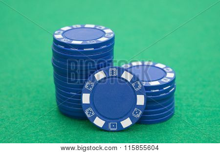 Lots Of Blue Poker Chips On Casino Table
