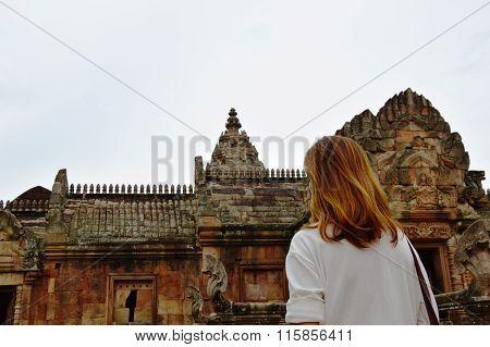 traveler on Phanom Rung stone castle in Thailand