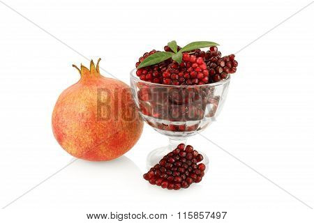 pomegranate, peeled a slice of pomegranate and beans in a bowl, isolated on white background
