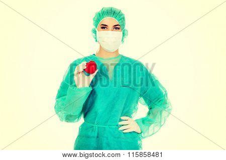 Female surgeon doctor holding heart