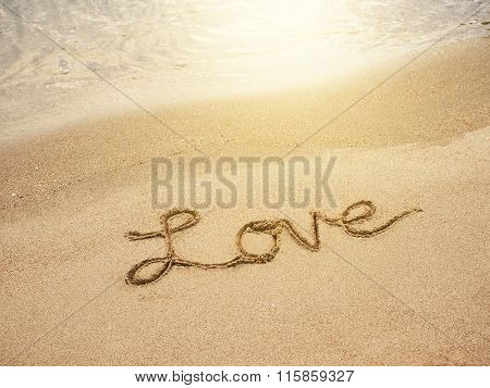 Love Lettering Message Written On Sand Beach Background