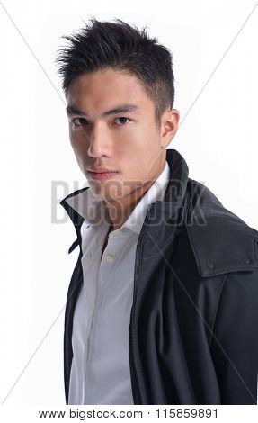 portrait of a young casual young man posing