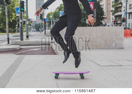Detail Of A Model Jumping With His Skateboard