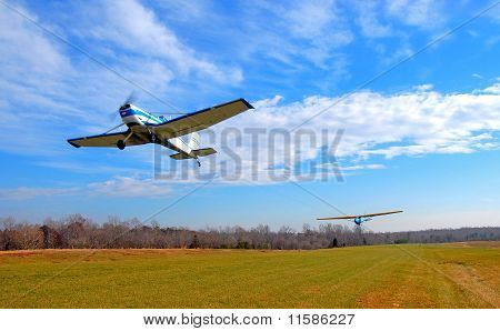 Aircraft towing a glider into the air