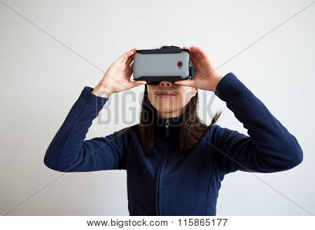 Young Woman wearing with virtual reality device