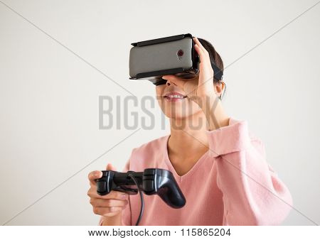 Asian Woman play with the virtual reality device