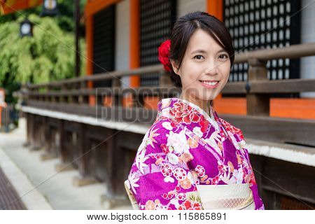 Young Woman with kimono dress at traditional temple